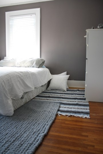 """The master bedroom """"before"""". Lower bed means seemingly taller ceilings and more walking space."""