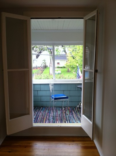 Two upstairs bedrooms open to a shared, enclosed porch.