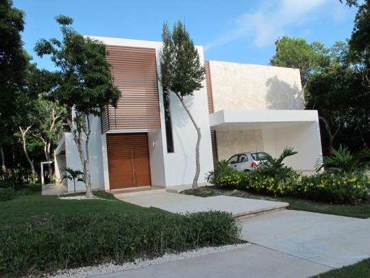 Beautiful, functional home with a sleek garage overhang.