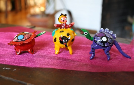 Miniature bobble heads bought in Playa del Carmen. Dinosaur, turtle, and bull with rider.