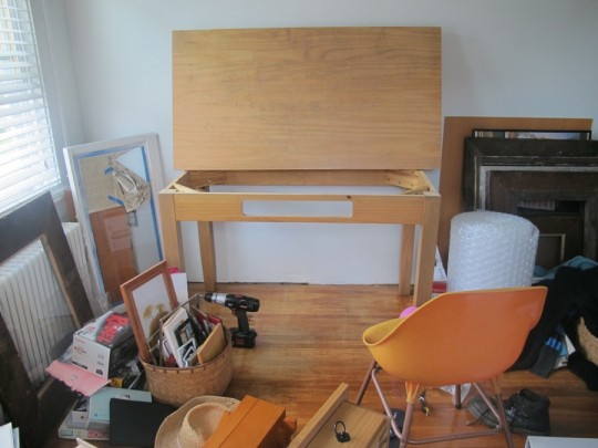 Disassembling the desk to prep for painting.