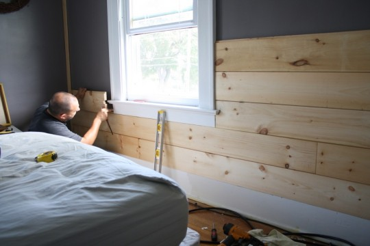 Fitting boards around the window sill, working up from the bottom.