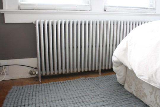 A silvery bedroom radiator.