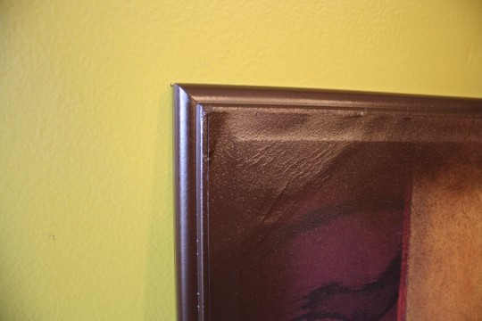 I spraypainted the edge of the frame (which as you'd expect, also coated some of the canvas).