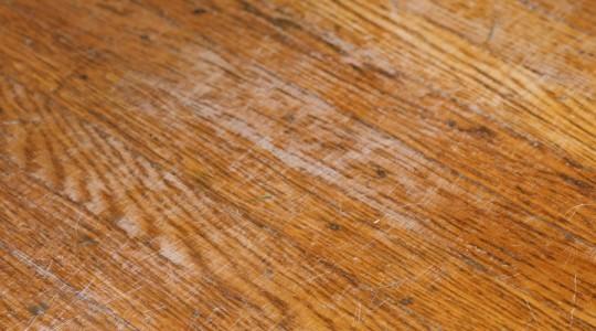 A damaged dining room floor.