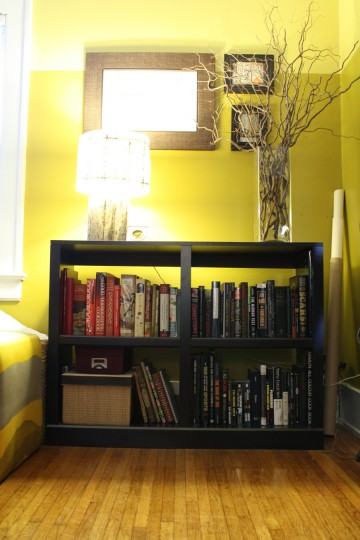 Neutralizing this smaller shelf. Starting to fill it with black-spined books.
