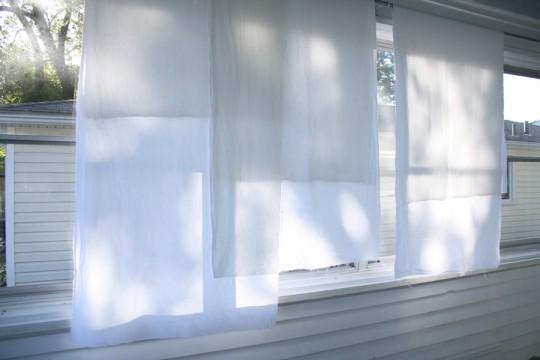 Three panels of future sunroom curtains. Letting the light shine through.