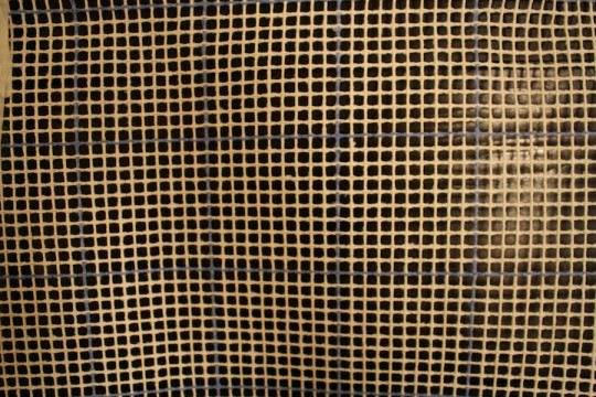 Grid on the latch hook fabric.