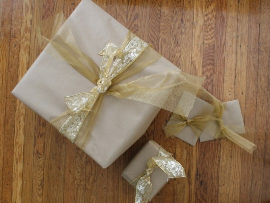 Craft paper and gold assorted ribbons.