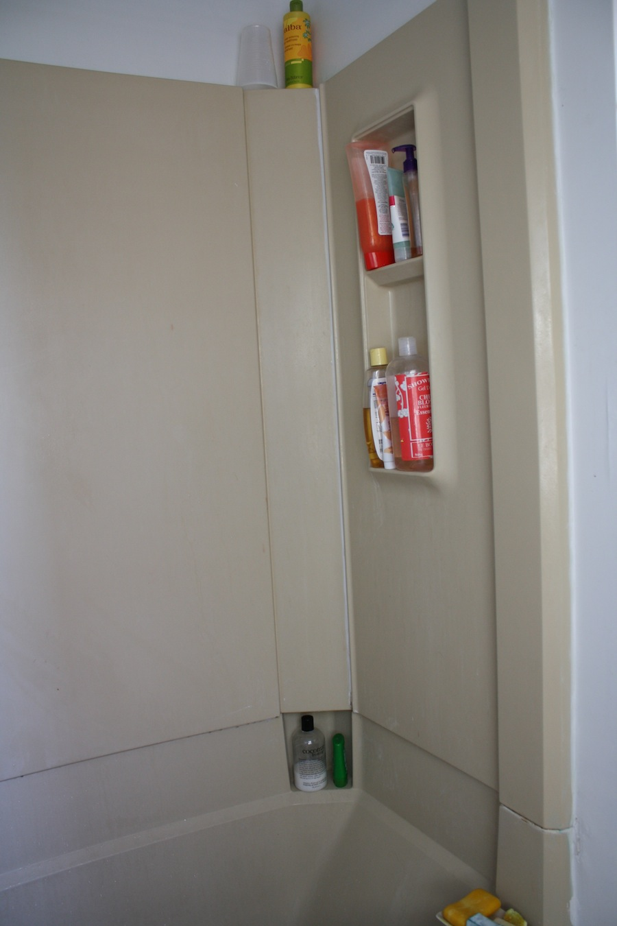 Tiny bathroom shelves that need to be bigger.