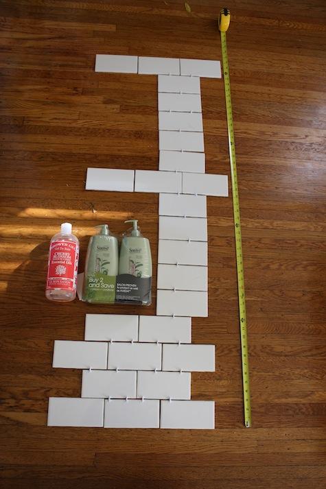 Deciding how big to make shelves in a shower for a DIY bathroom remodel.