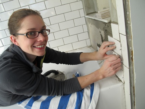 DIY tiling with subway tile in a shower surround.