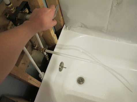 Testing the new plumbing for the bathtub.