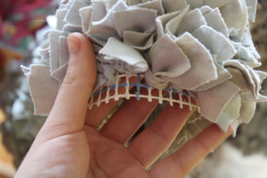"""Trimming the excess fabric away from the bear, leaving 1/2"""" excess for binding."""
