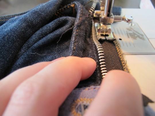 Sewing a new denim zipper.