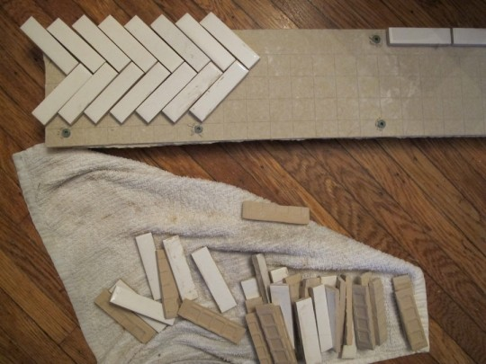 "Dryfitting pieces of 3/4""x3"" subway tile to the HardiBacker."