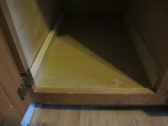 "I fit 22"" pieces of furring strip along the sides of the cabinet to even out the framing issue."