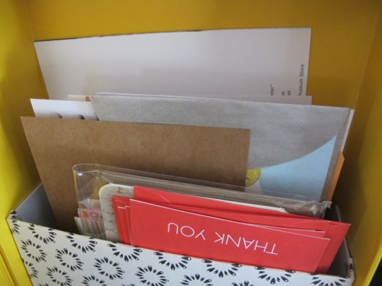 Filling the new folder in the upcycled shoebox.