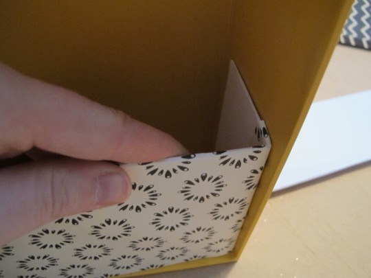 Fitting the little mat paper folder into place in the shoebox.