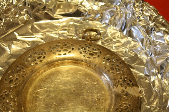 Put items on the tin foil. Touching together or not, didn't seem to make a huge difference.