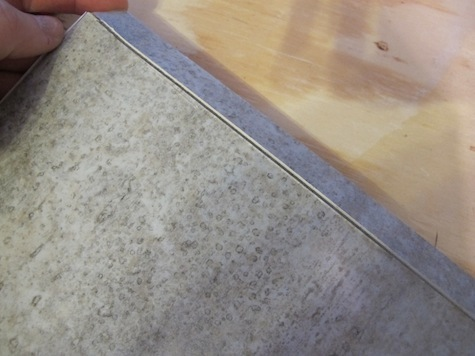 How to cut and install vinyl adhesive groutable tile.