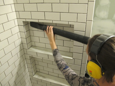 Cleaning tiles before adding grout.