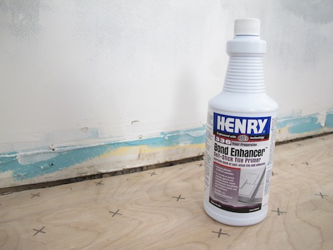 Prep the subfloor with bond enhancer before using adhesive tile.