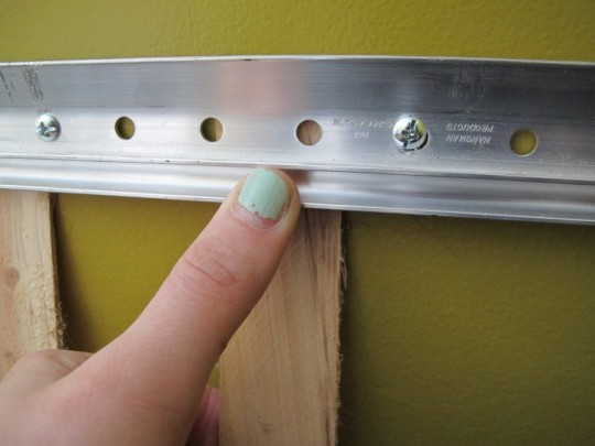 Putting shims behind the wall-mounted french cleat.