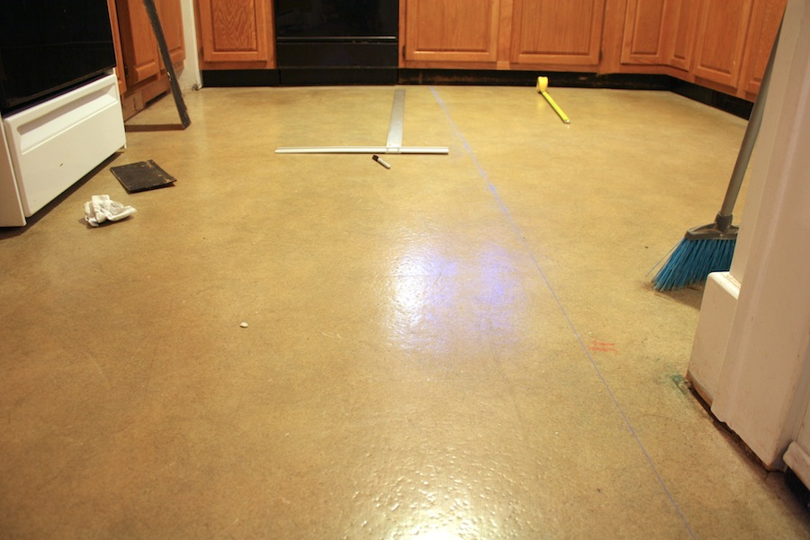 Preparing to lay floor tiles over vinyl sheet flooring for Floor prep for vinyl tile