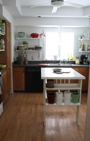 Kitchen, with fewer cabinets and open shelves.