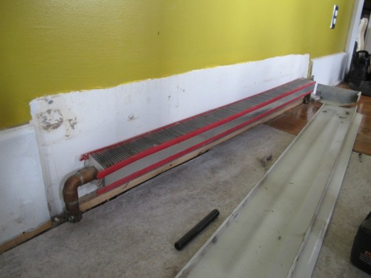 Removing the baseboard heating encasement.
