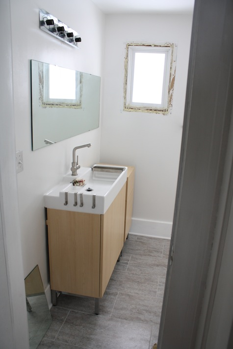 Narrow bathroom vanity and sink top via IKEA.