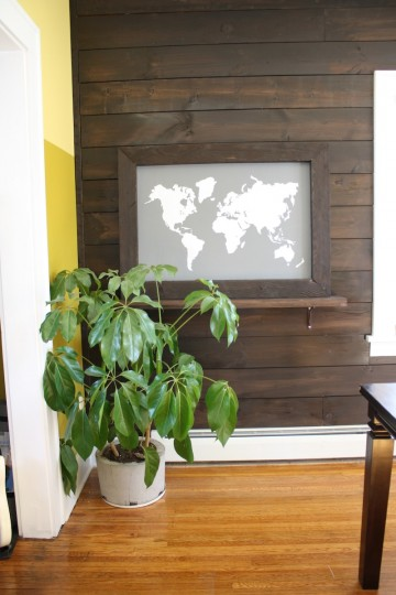 Pretty wall shelf featuring the world map.