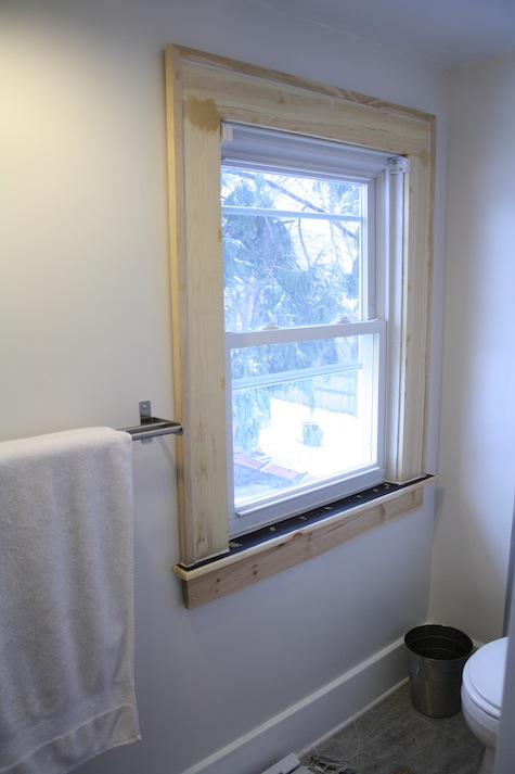 """Surrounding a window with 6"""" wooden trim."""