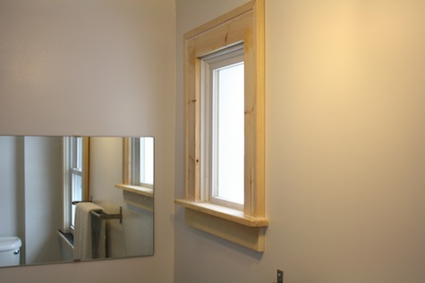 """Surrounding a window with 4"""" wooden trim."""