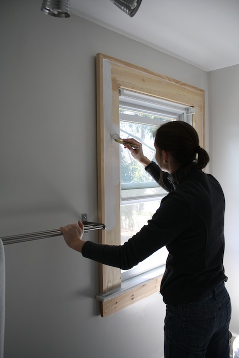 Painting wooden window trim.