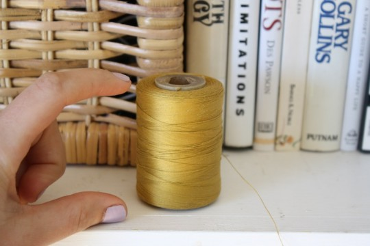 Sizable bolt of pretty golden thread.