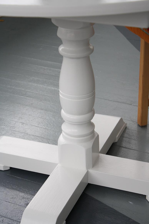 Glossy white pedestal.