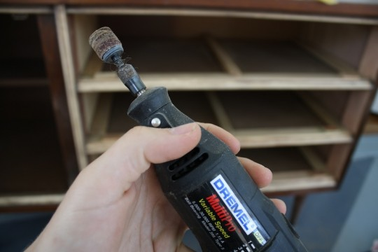 Using a Dremel bit with sanding attachment for the inset bevels on the dresser.