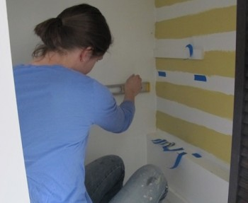 Painting a stairwell closet.
