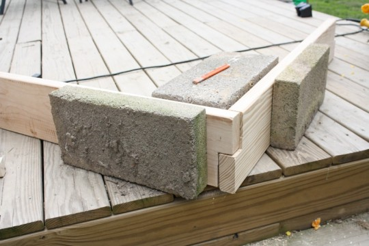 Cinderblocks. Always handy for anchoring lumber in place.