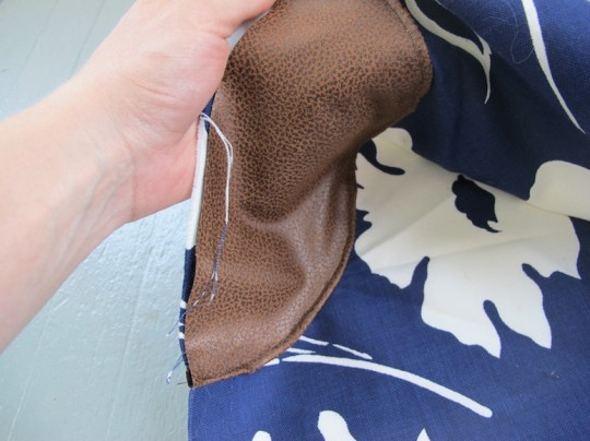 "Sewing the bag ""elbow patches"" into place."