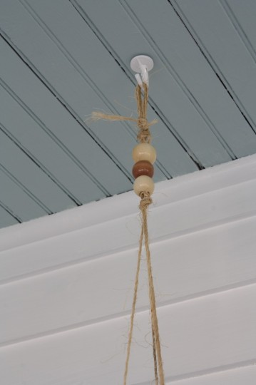 Twine and beads will hold the entire planter from the ceiling.