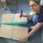 Organize the seats onto the piece of foam, and then cut the foam to size using a serrated bread knife.