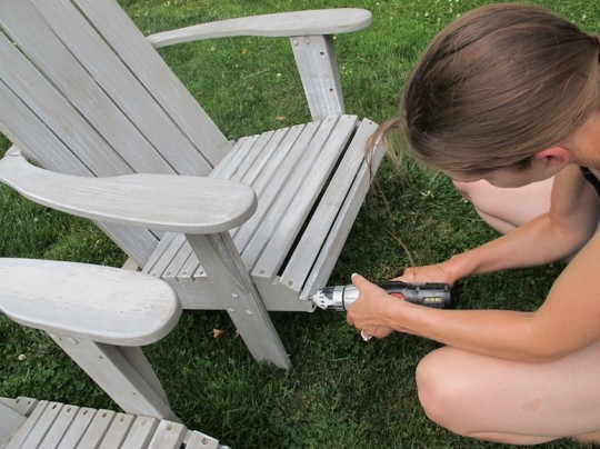 Tightening up the screws and bolts on the chairs.