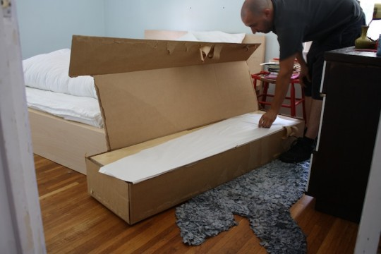 Assembling the IKEA Expedit.