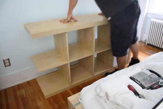 Finishing the IKEA shelf assembly.