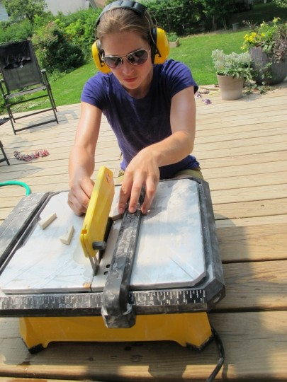 Cutting the tiles on the deck.