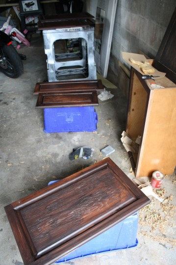 Cabinet doors sprawled out in the garage.