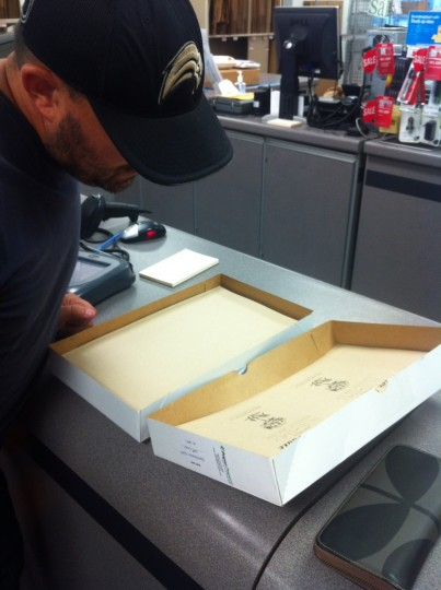 Pete, carefully proofing the first print of the save the date cards at Kinko's.
